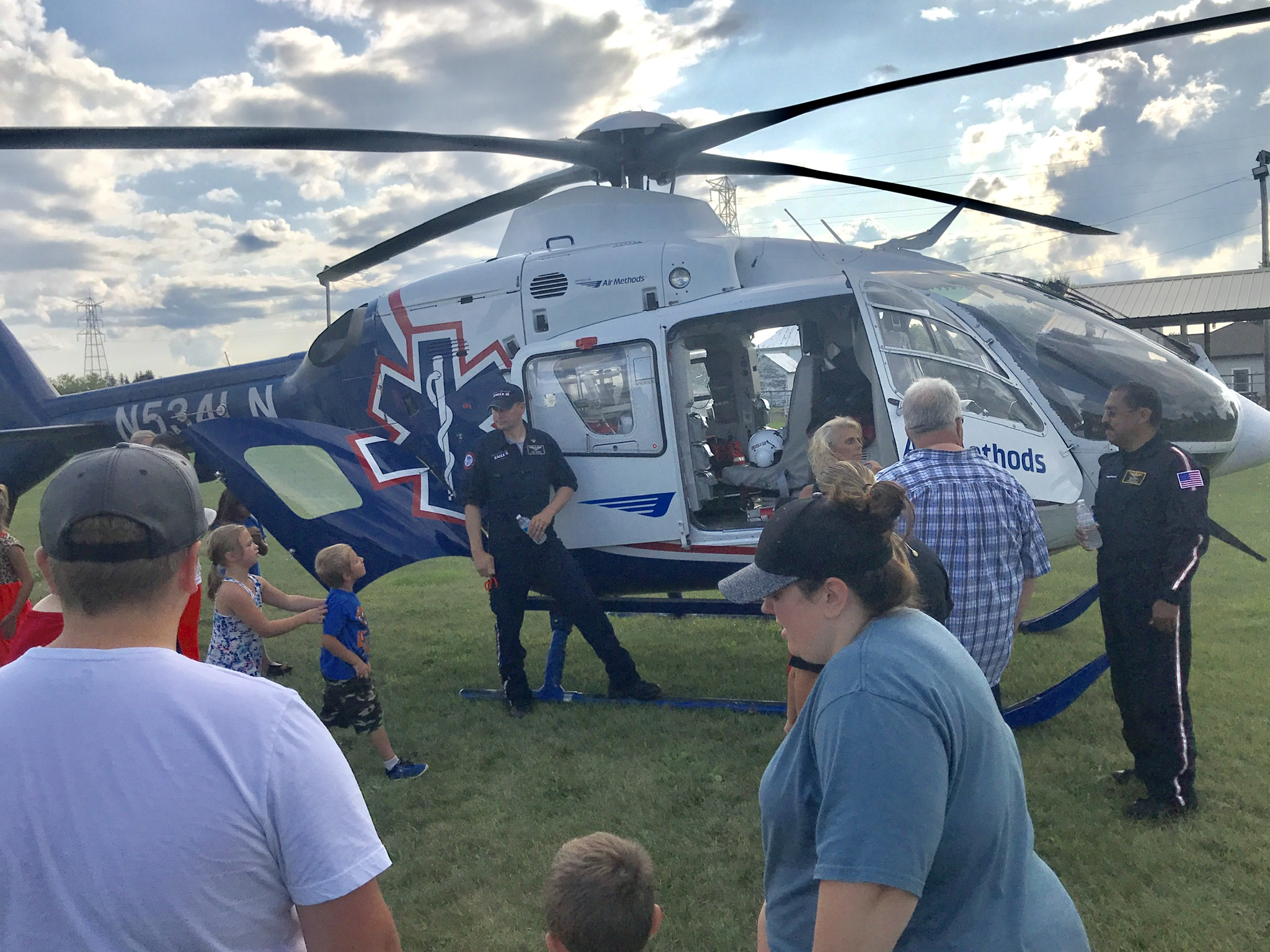 Eagle III crew explains the helicopter's functions to visitors.