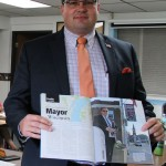 """In August 2018 then-Mayor James Beaton displays an """"American Funeral Director"""" magazine profile written about his dual role as Gillett mayor and funeral director. Beaton now faces 13 charges of theft in a business setting. File 