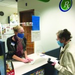 Pharmacist Katie Hanke answers questions her customers have about COVID-19.