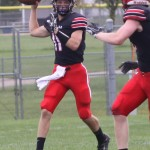 Shawano's Carson Popp, left, prepares to pass the ball during the team's nonconference win over Marinette on Aug. 28 in Shawano.  Morgan Rode   NEW Media