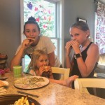 Sarah and Wes School's daughter Lennon enjoys the Appreciation Meal with her big sisters.  Contributed