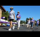 Walkers with Zion Lutheran Church walk around the church's parking lot Saturday as part of a fundraiser for the American Cancer Society. This is the 25th year that Zion has participated in Relay for Life. Fifty people came out to participate, ranging in age from 10 years to 80 years. About $4,500 was expected to be raised, even though the main event for 2020 had to be called off after the pandemic hit in March.  Lee Pulaski | NEW Media