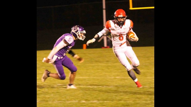 Shawano's Elliott Lowney, right, runs with the football during Friday's nonconference game against Marinette in Shawano.  Morgan Rode | NEW Media