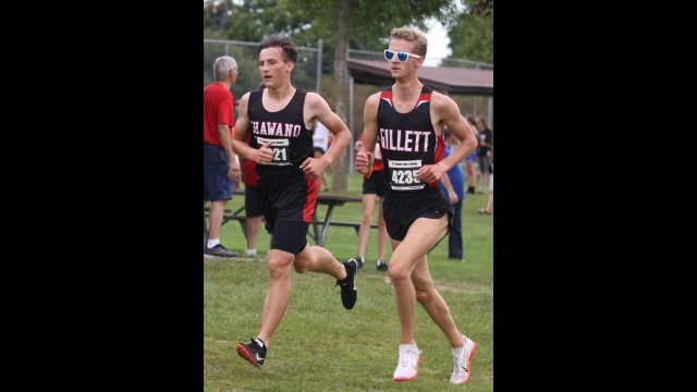 Shawano's Ethan Onesti, left, battles for position with Gillett's Alex Peterson during the Shawano Invitational on Sept. 11 in Shawano. Onesti led the Shawano boys team with an eighth-place finish overall.  Morgan Rode   NEW Media