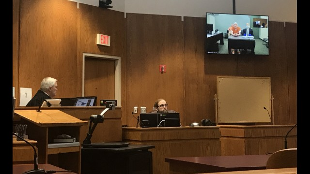 Judge James Morrison, left, addresses murder suspect Raymand Vannieuwenhoven and his attorney Travis Crowell via a video connection to the Marinette County Jail, during a competency hearing Thursday.