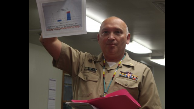 Dr. Robert Chelberg with the Menominee Tribal Clinic, holds up a graph showing how medical and behavioral health visits for narcotic addiction has more than quadrupled between 2016 and 2018. Chelberg said this is a good sign that drug issues are being dealt with on the reservation, but it has maxed out available resources at the clinic.  (Lee Pulaski | NEW Media)