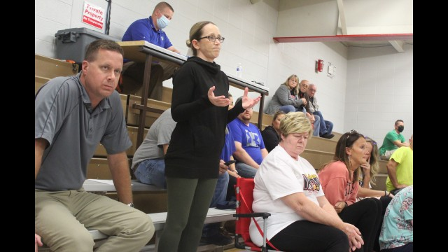 Jen Brady, a parent with the Gresham School District, expresses her frustration Sept. 13 with the district's sudden announcement that the school was closing the next day due to an increase in COVID-19 cases. She and other parents also were upset with the school board voting on a masking policy that put the decision in its hands instead of the school's administration. (Lee Pulaski   NEW Media)