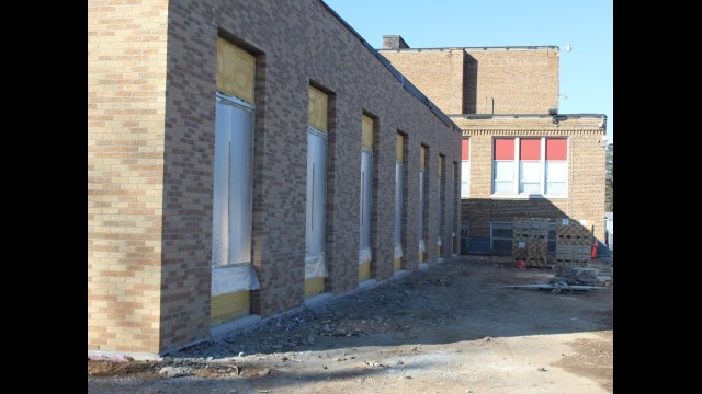 Aside from the construction materials, the new wing's exterior looks similar to the existing Gresham Community School. Superintendent Newell Haffner said community members have been driving by the school regularly to observe the progress.  (Lee Pulaski | NEW Media)