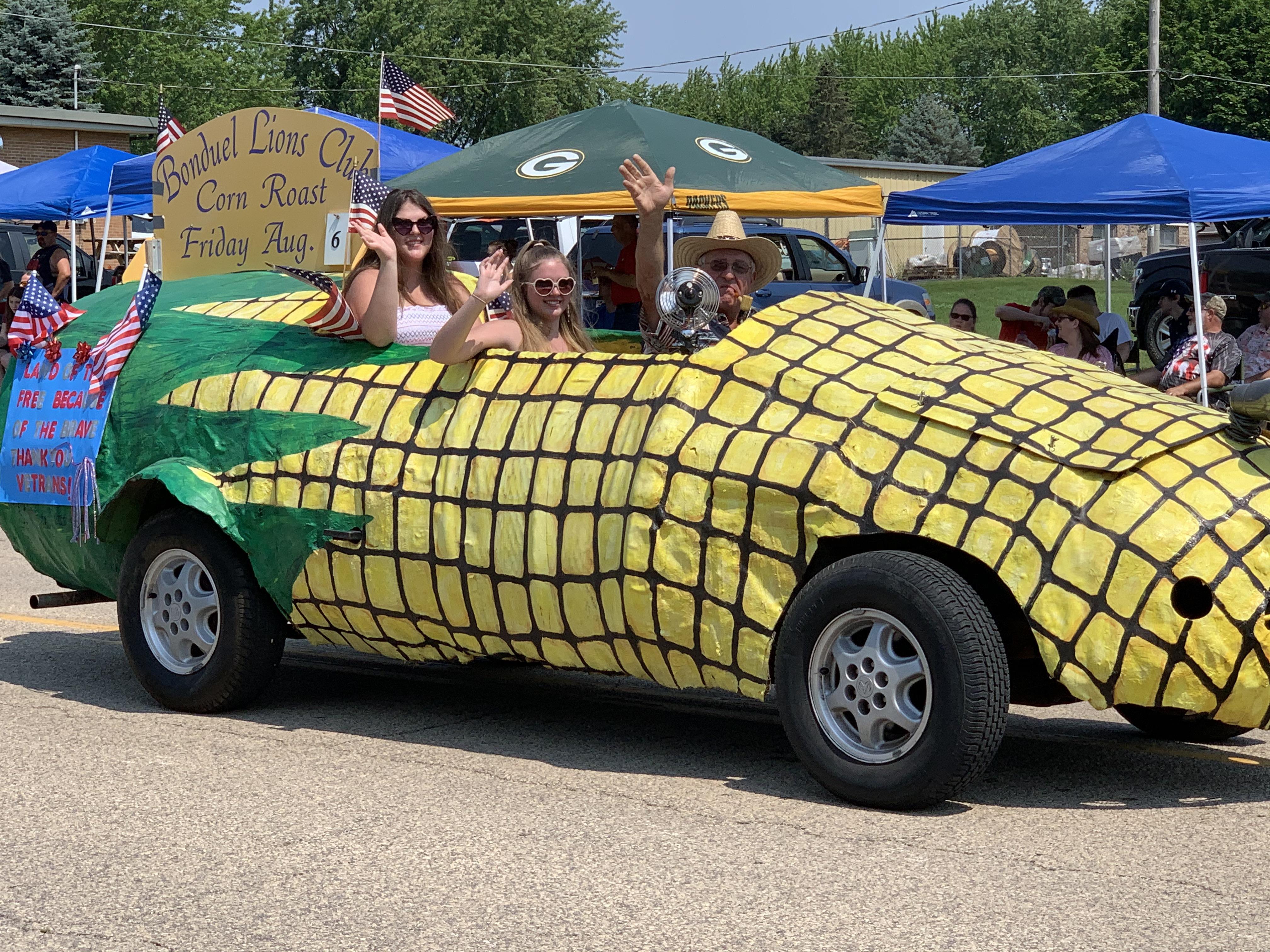 A corn-mobile drives down Green Bay Street, promoting the Bonduel Lions Club's upcoming corn roast, on July 4 in Bonduel.Luke Reimer   NEW Media