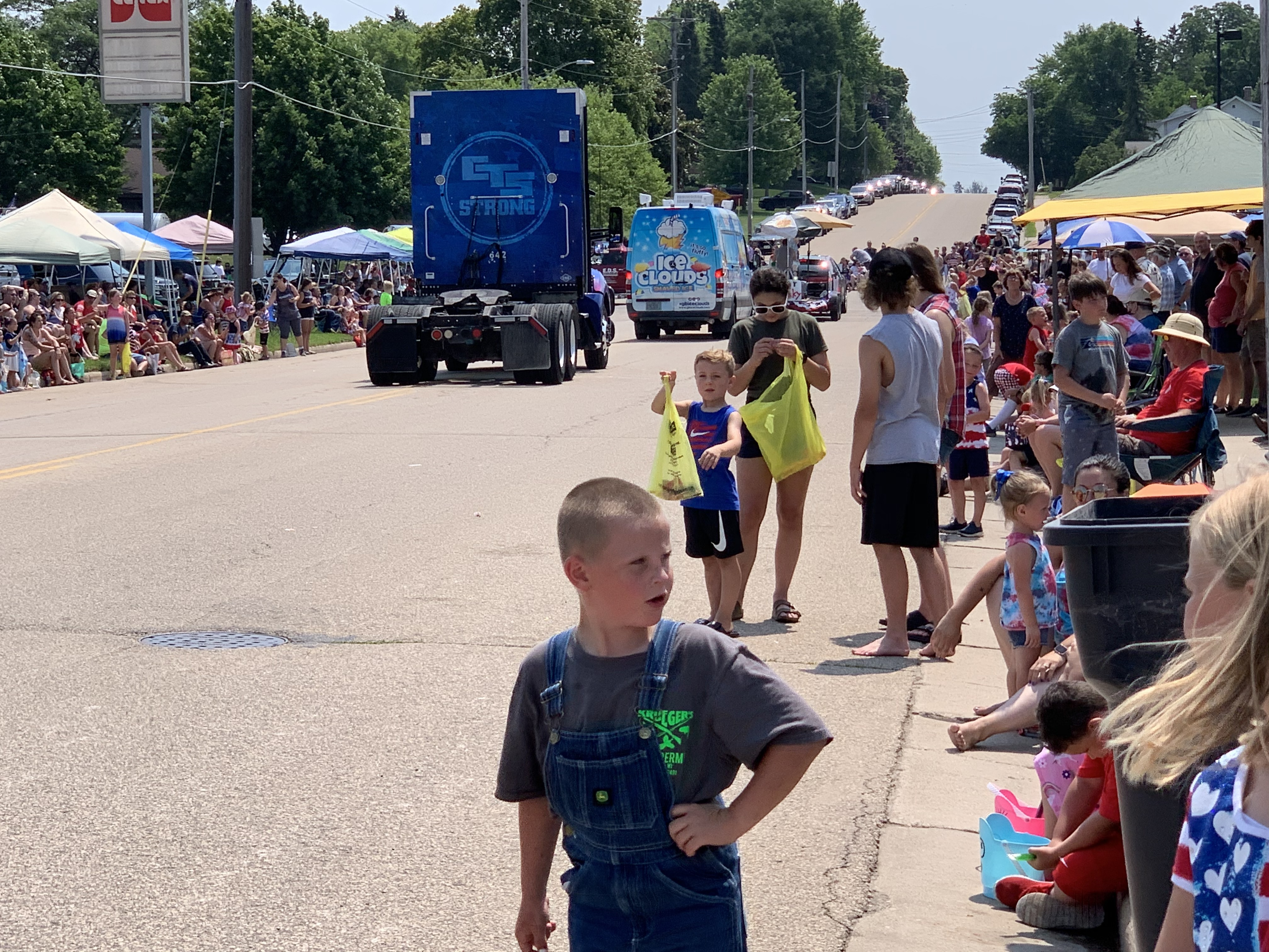 Children and teenagers wait to collect candy from parade floats in Bonduel on July 4.Luke Reimer   NEW Media