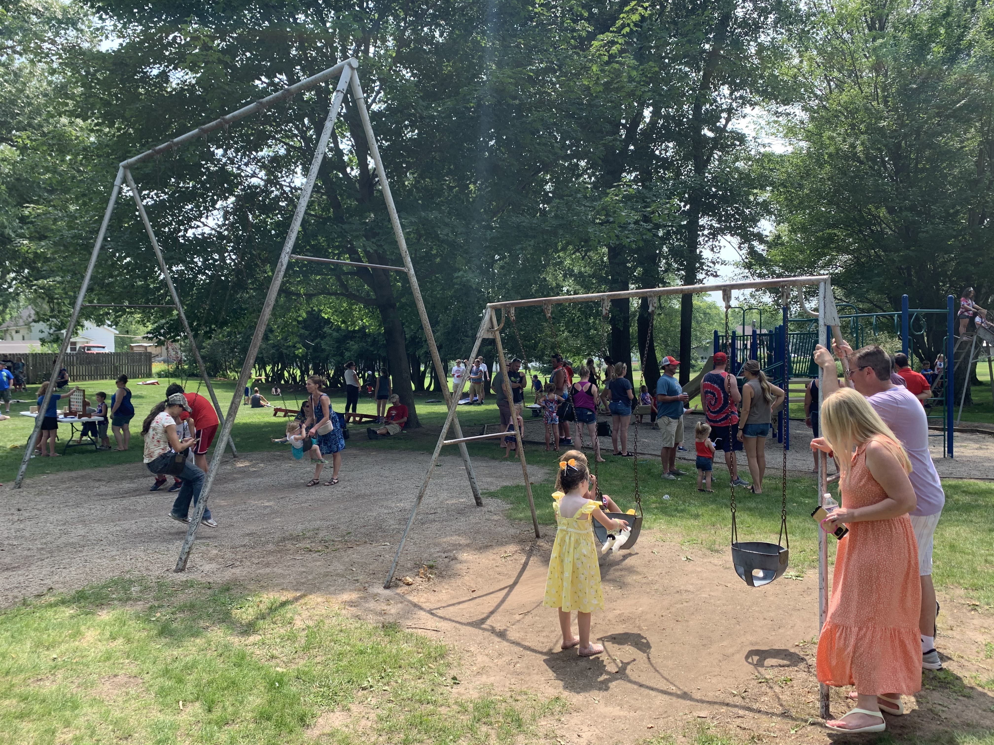 Families take a break from the Fourth of July celebration activities to play in Village Park in Bonduel on July 4.Luke Reimer   NEW Media