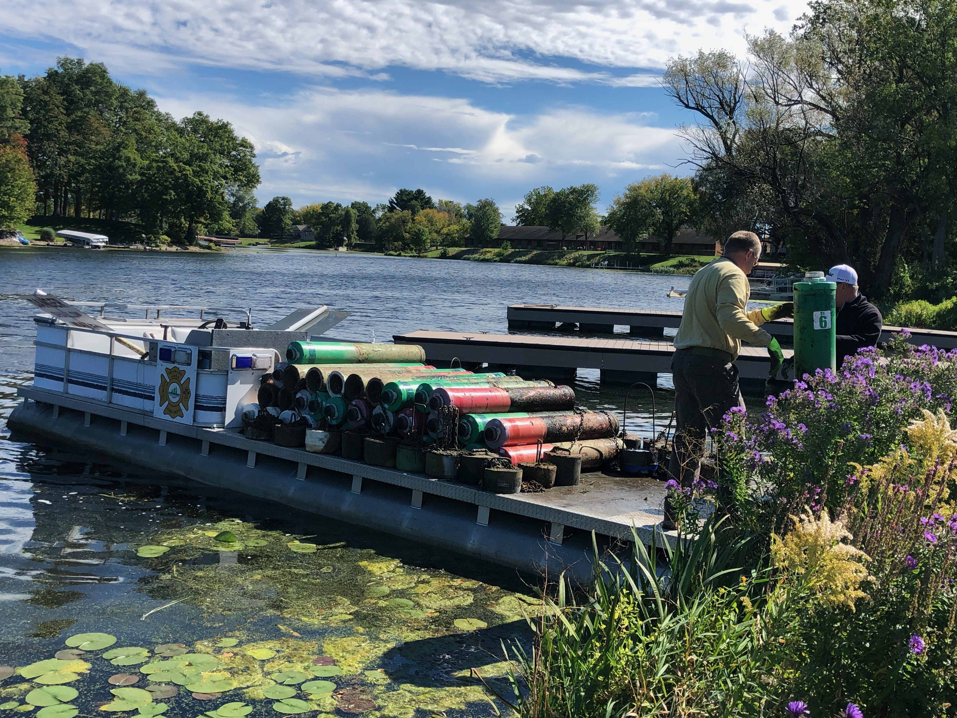 Members of the Shawano Area Waterways Management remove buoys from various waterways around Shawano in preparation of the fall season.Contributed