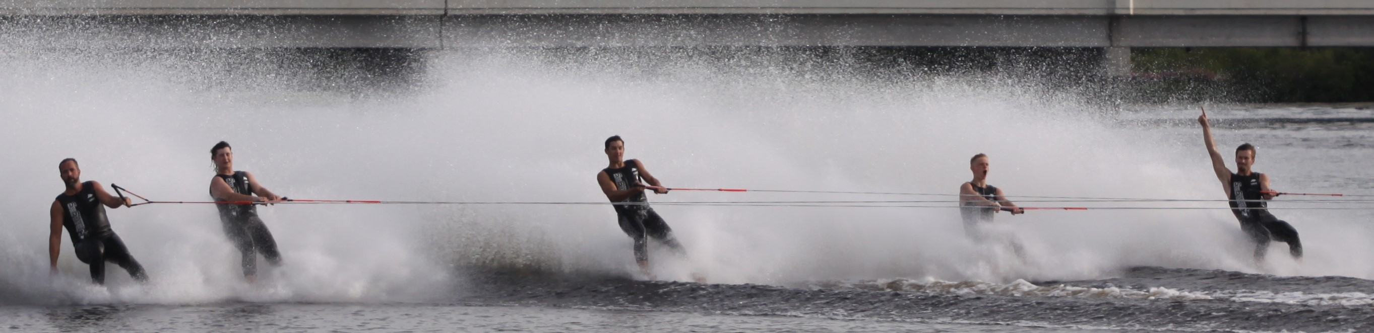 Shawano Ski Sharks barefoot skiers look to the crowd while performing during the Shawano Ski Sharks show on Wednesday. A big crowd showed up for the Ski Sharks final show of 2020.Morgan Rode | NEW Media