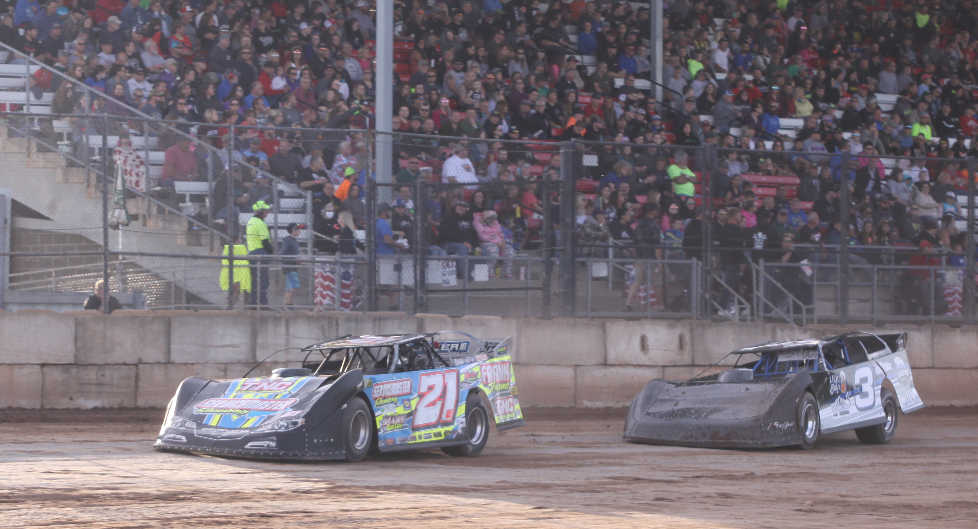 Todd Frank (21) and Brett Swedberg (3) compete during a Late Model heat race during Saturday&#039;s season opener at Shawano Speedway.<br />Morgan Rode | NEW Media