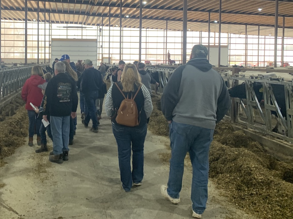 Dozens of Shawano and Oconto County residents pack the walk ways of the barn to get a closer look at the cows on April 24. Visitors were also treated to a lunch of burgers or brats, cheese curds, vanilla ice cream and milk.<br />Luke Reimer | NEW Media