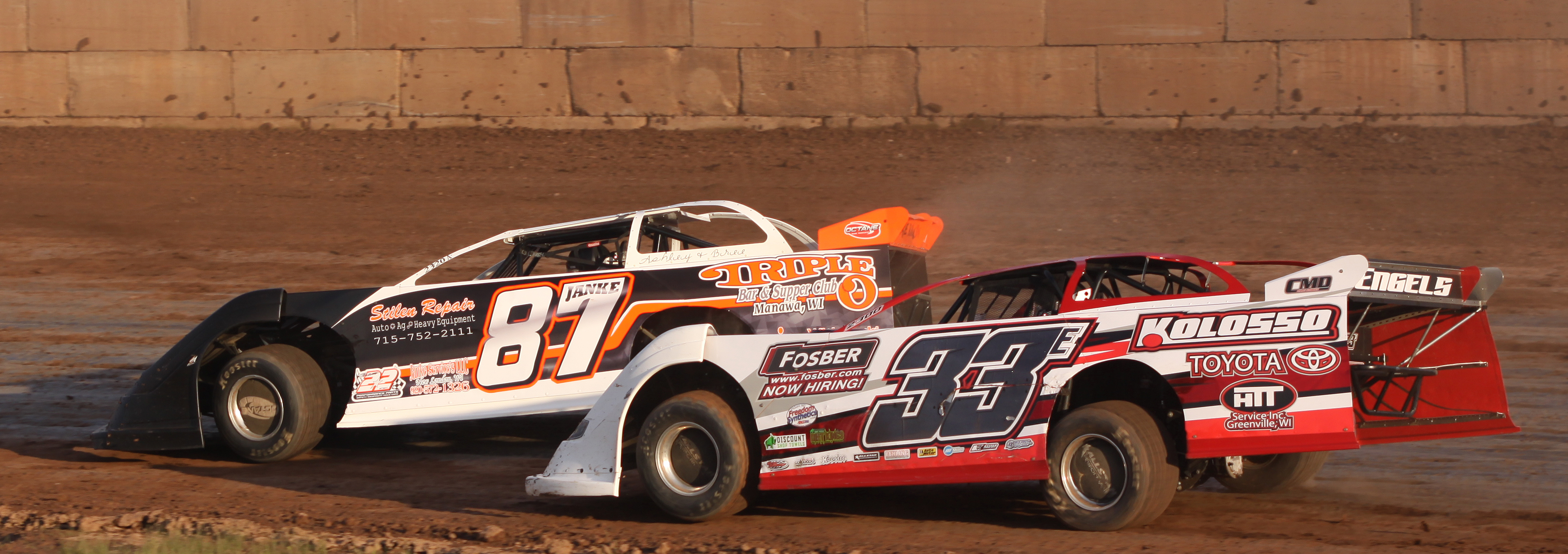 Adam Janke (87) and Chris Engels (33) round a turn during a Late Model heat race during Saturday&#039;s season opener at Shawano Speedway.<br />Morgan Rode | NEW Media