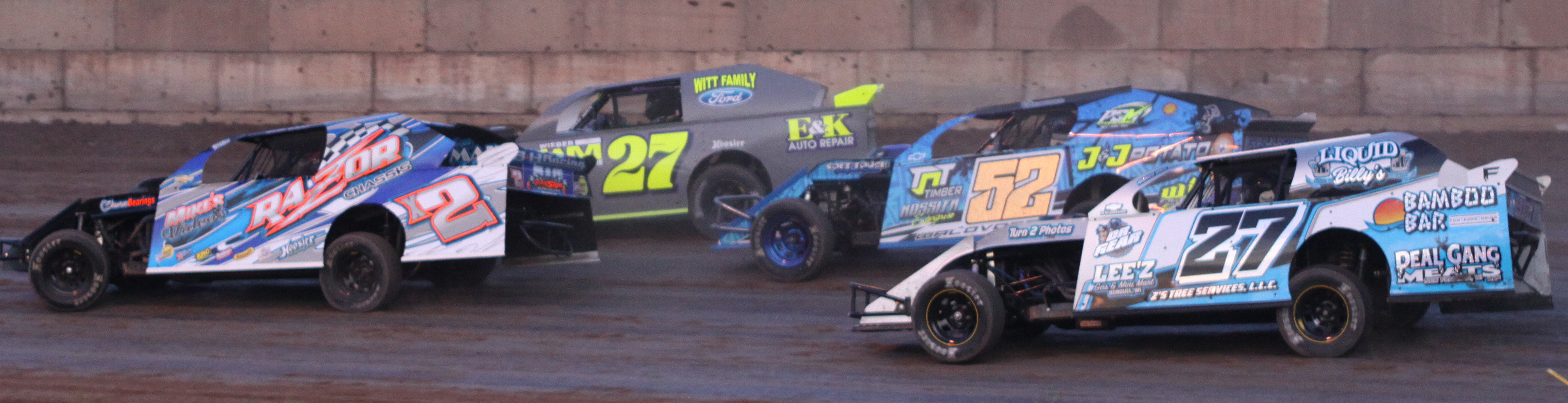Hollie Welch (2), Tyler Sobiesczyk (27), Dylon Waldvogel (52) and Sean Falk (27) round a corner during an IMCA Sport Mod race during the Shawano Speedway&#039;s season opener on Saturday.<br />Morgan Rode | NEW Media