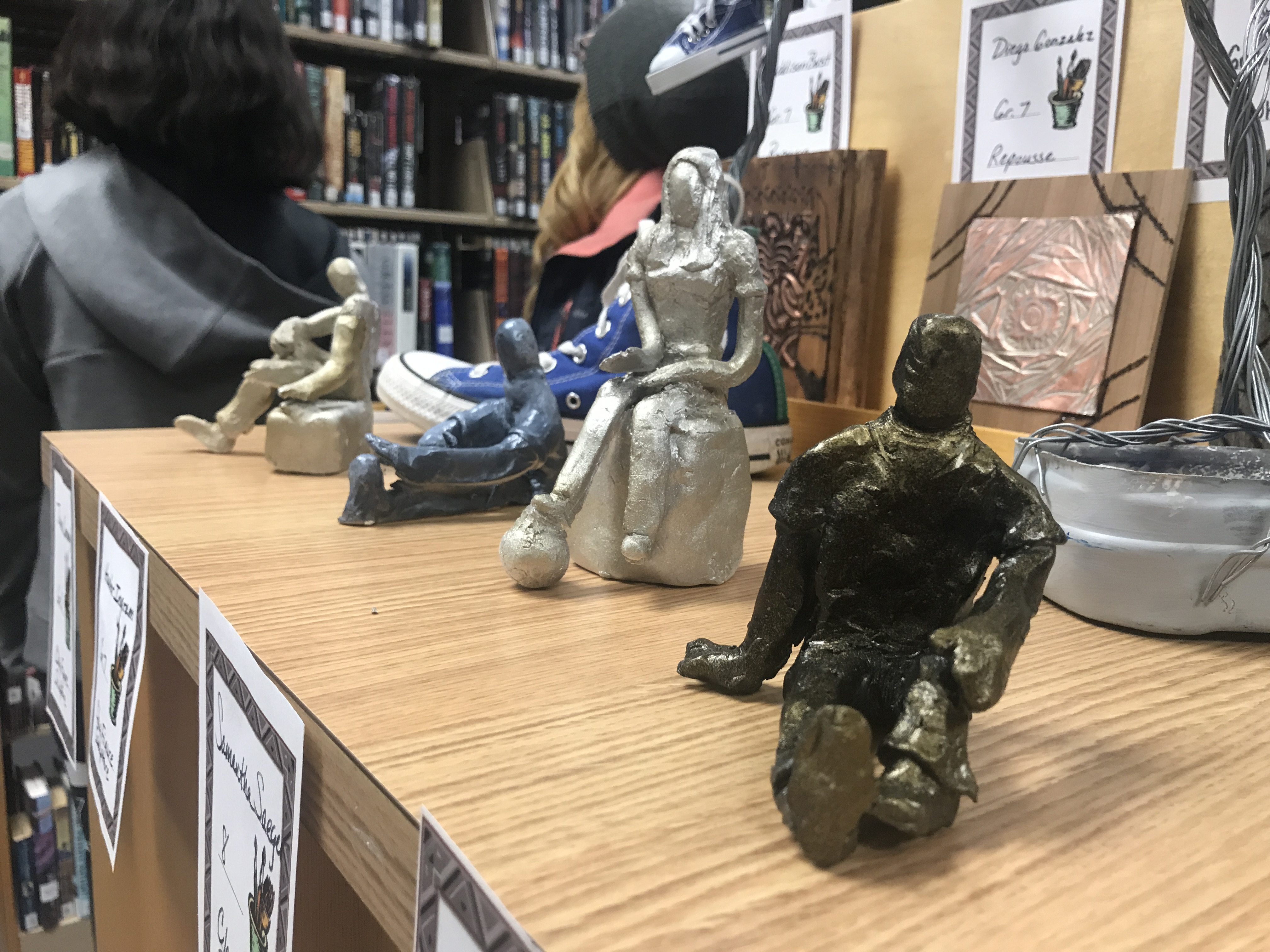 Figurines by Washington Middle School seventh-graders watch over a shelf. Warren Bluhm | NEW Media