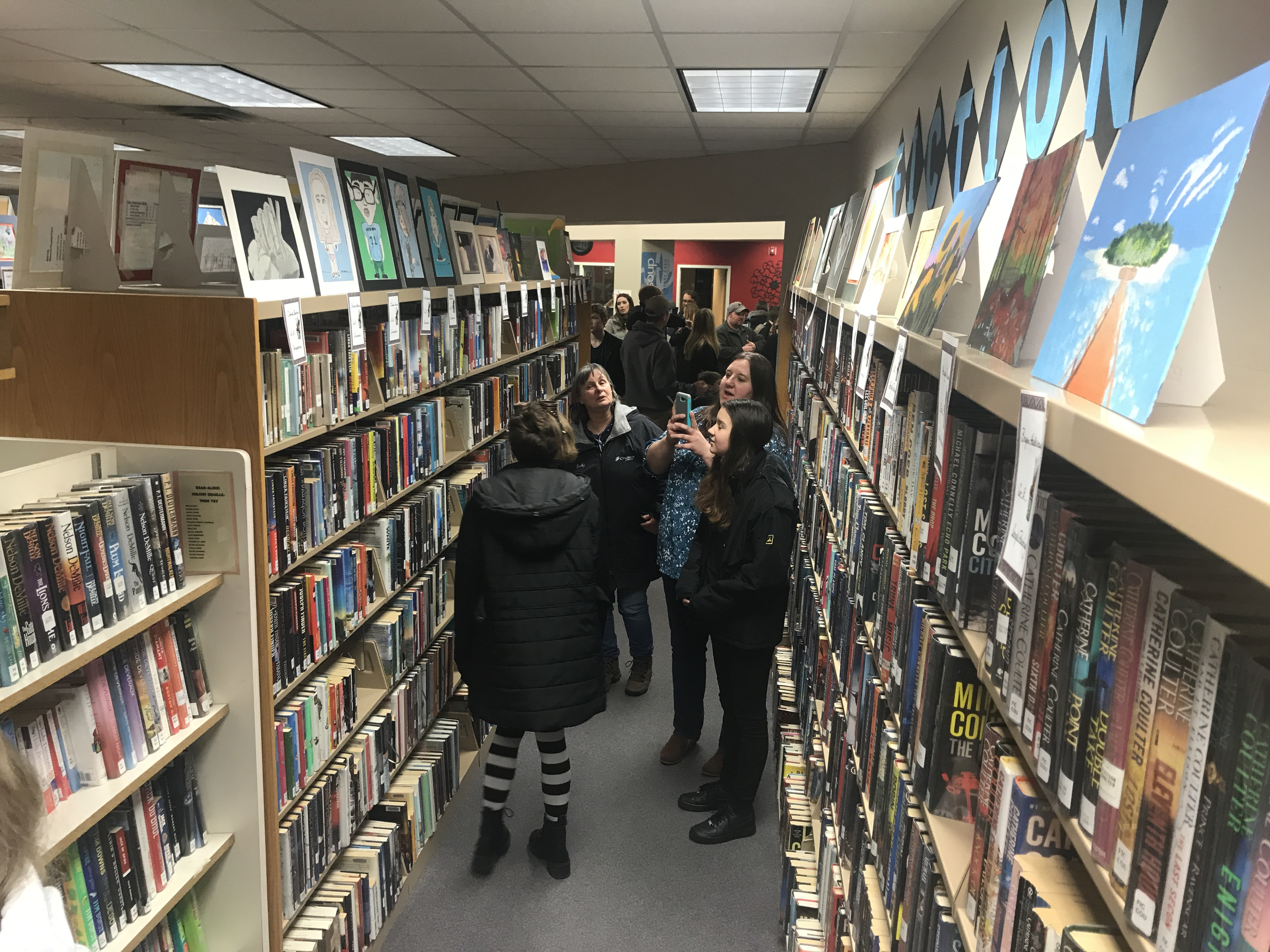 Every bookcase at Oconto Falls Community Library is topped by student artwork through the month of March. Warren Bluhm | NEW Media