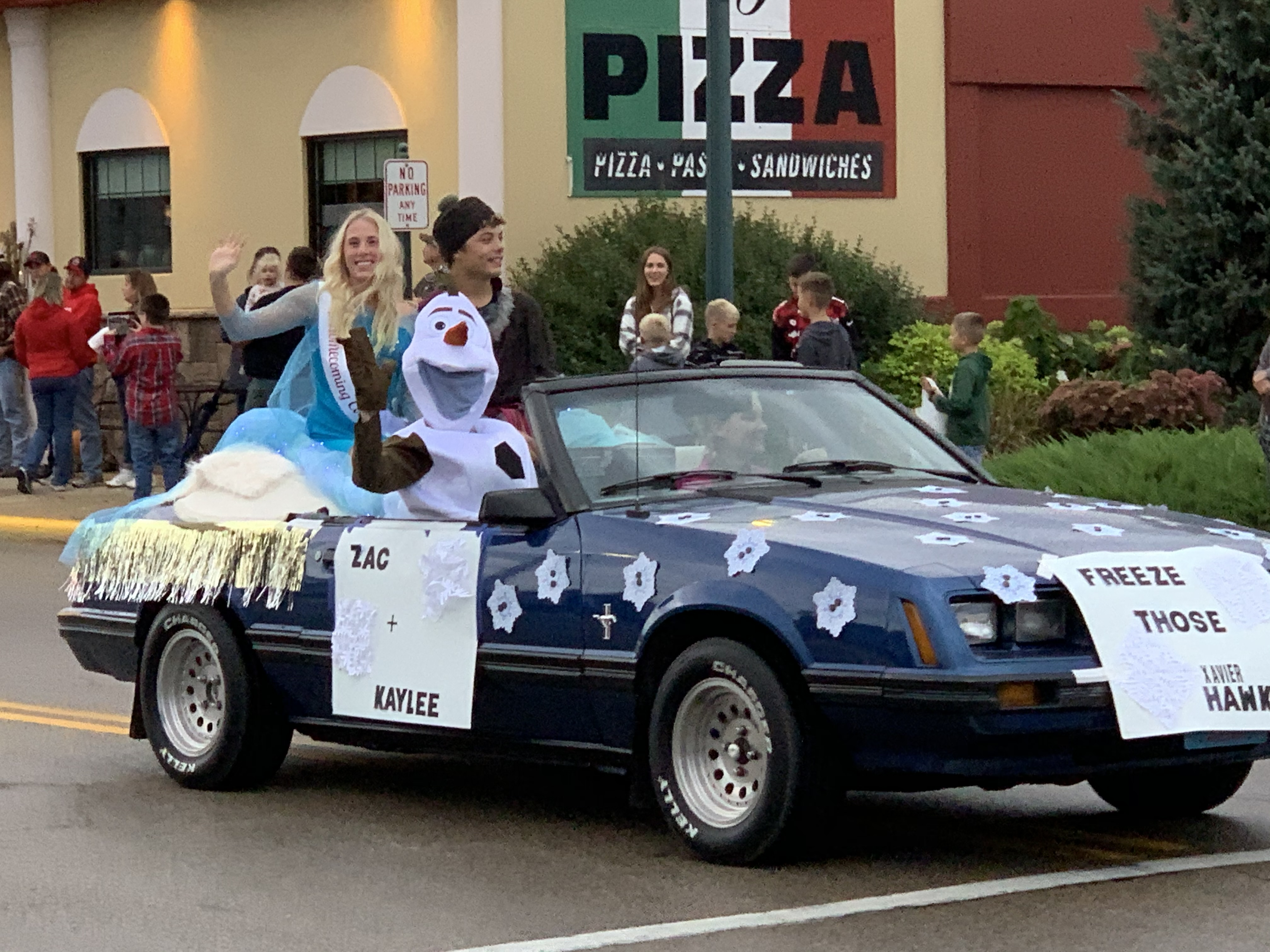 """In an effort to """"freeze"""" the rival Xavier Hawks, a float containing the """"Frozen"""" character Olaf greets visitors on Main Street during the Sept. 24 homecoming parade.Luke Reimer   NEW Media"""