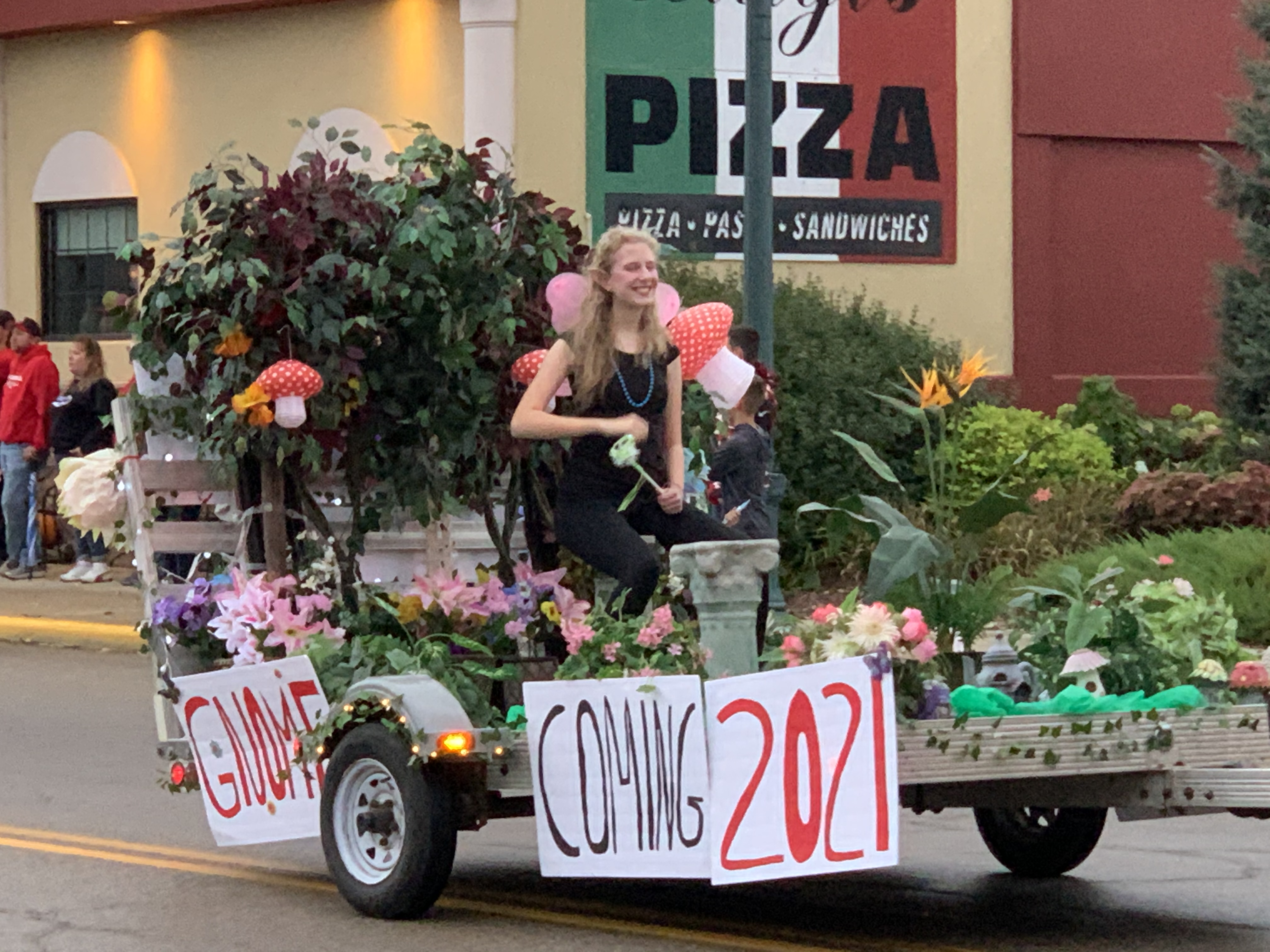 """With a play on the word """"homecoming,"""" one float features grass and a gnome — titled """"gnomecoming"""" — during the traditional parade Sept. 24.Luke Reimer   NEW Media"""