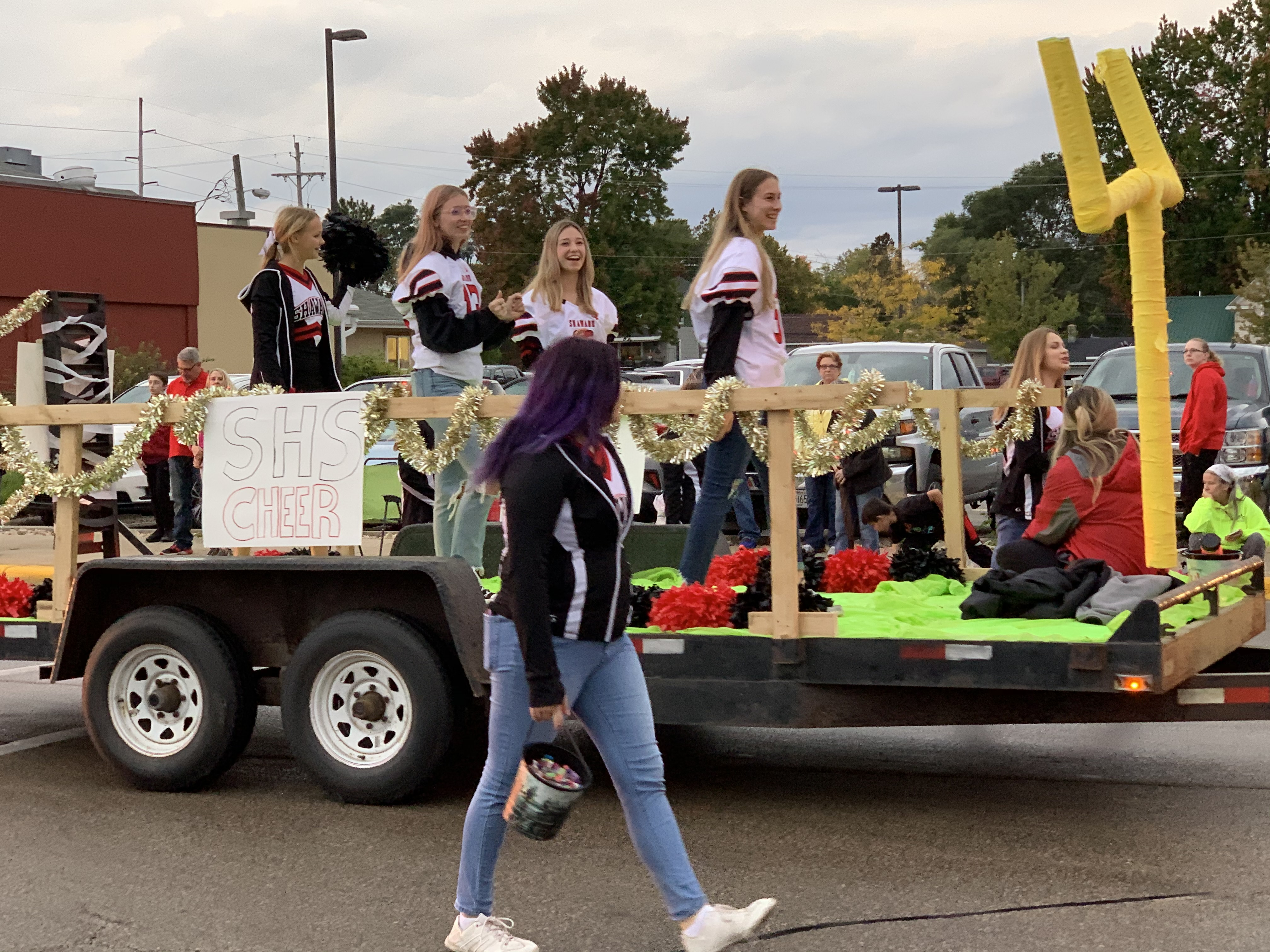 The Shawano cheer squad marches down Main Street in a football field-themed float during the Sept. 24 homecoming parade.Luke Reimer   NEW Media