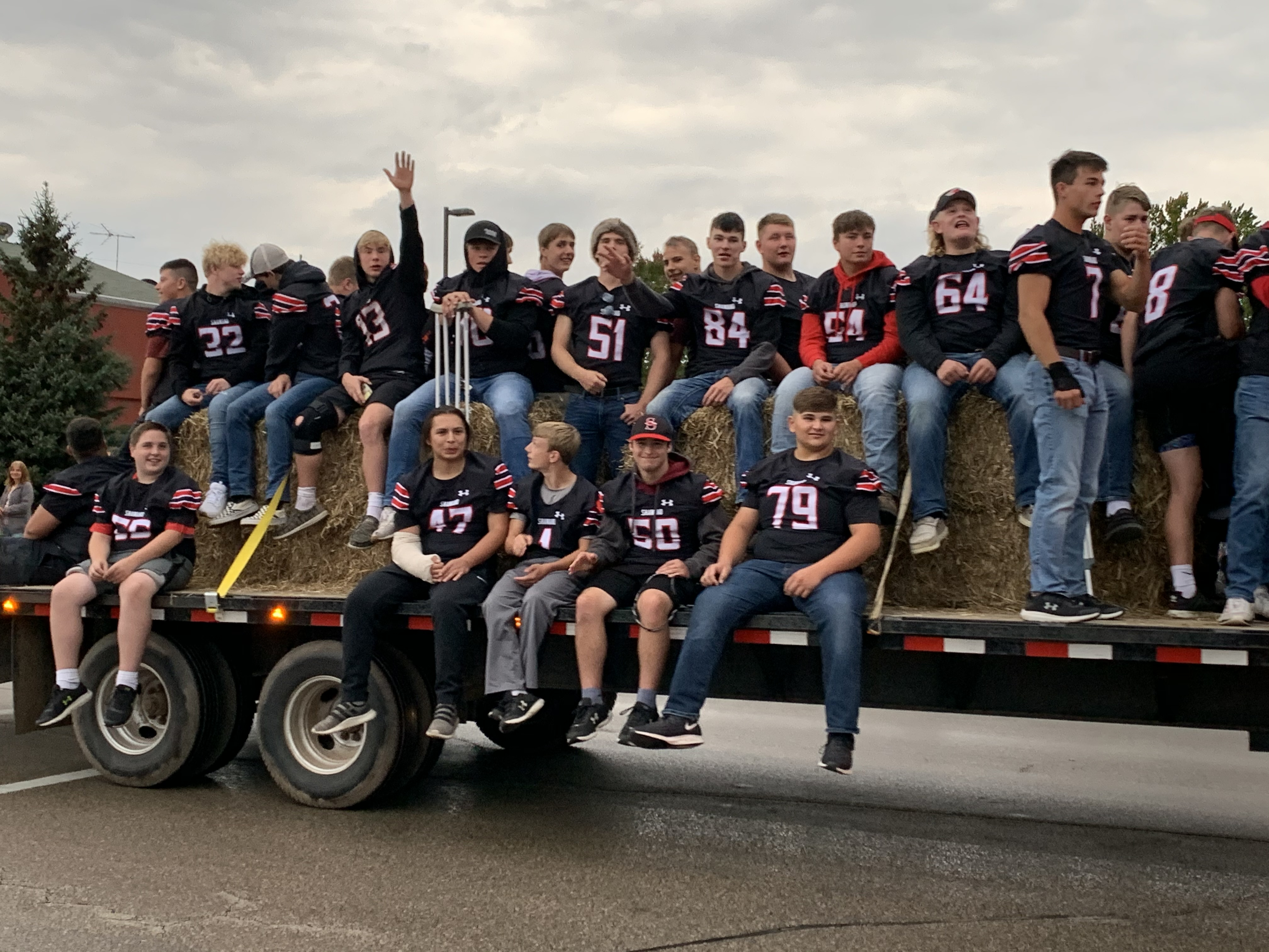 Shawano football players wave to visitors at the homecoming parade as they prepare to take on the Xavier Hawks on Sept. 24.Luke Reimer   NEW Media