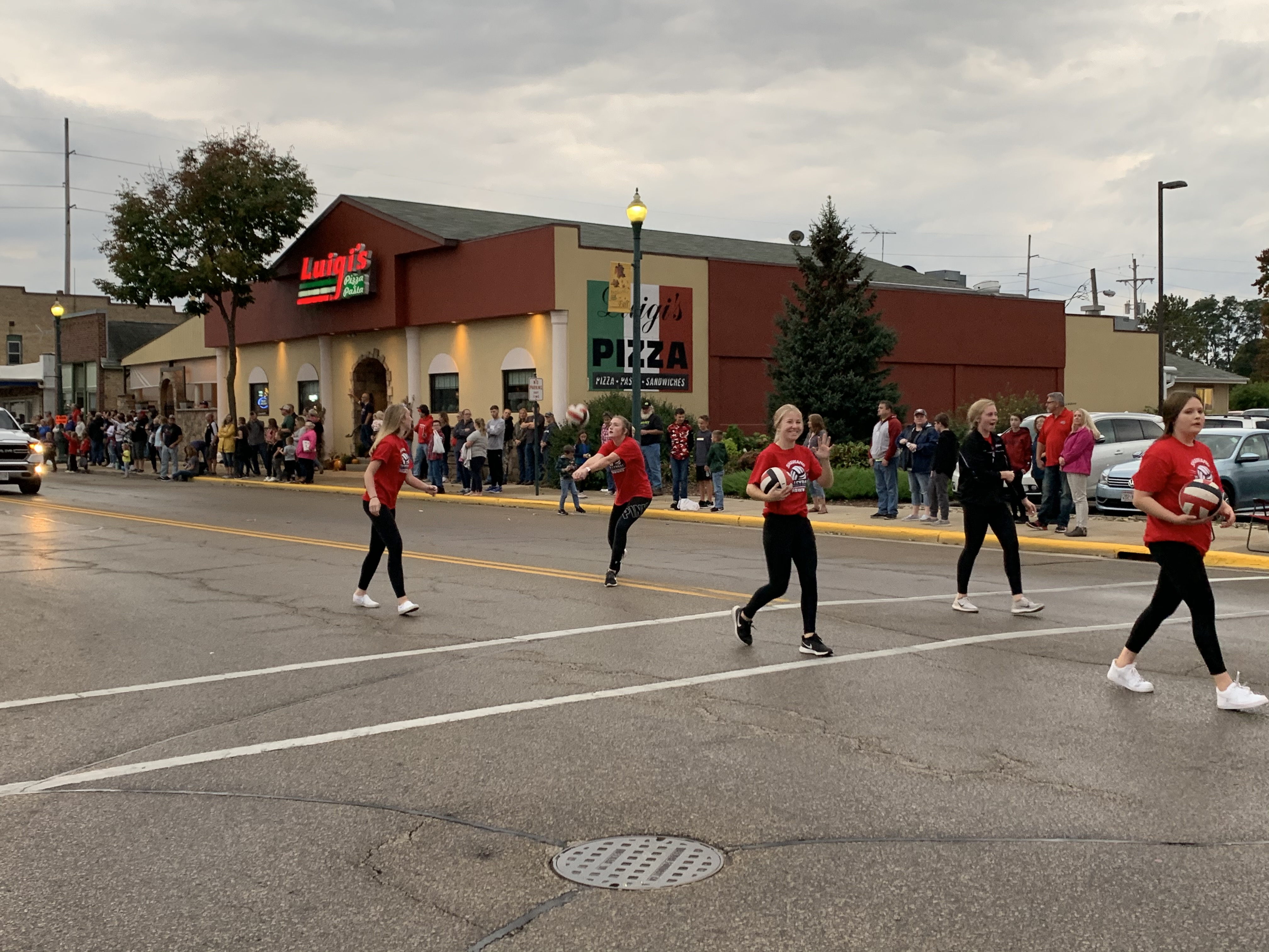 The Shawano volleyball team bumps, sets and spikes balls back and forth as they march down Main Street during the homecoming parade on Sept. 24.Luke Reimer   NEW Media