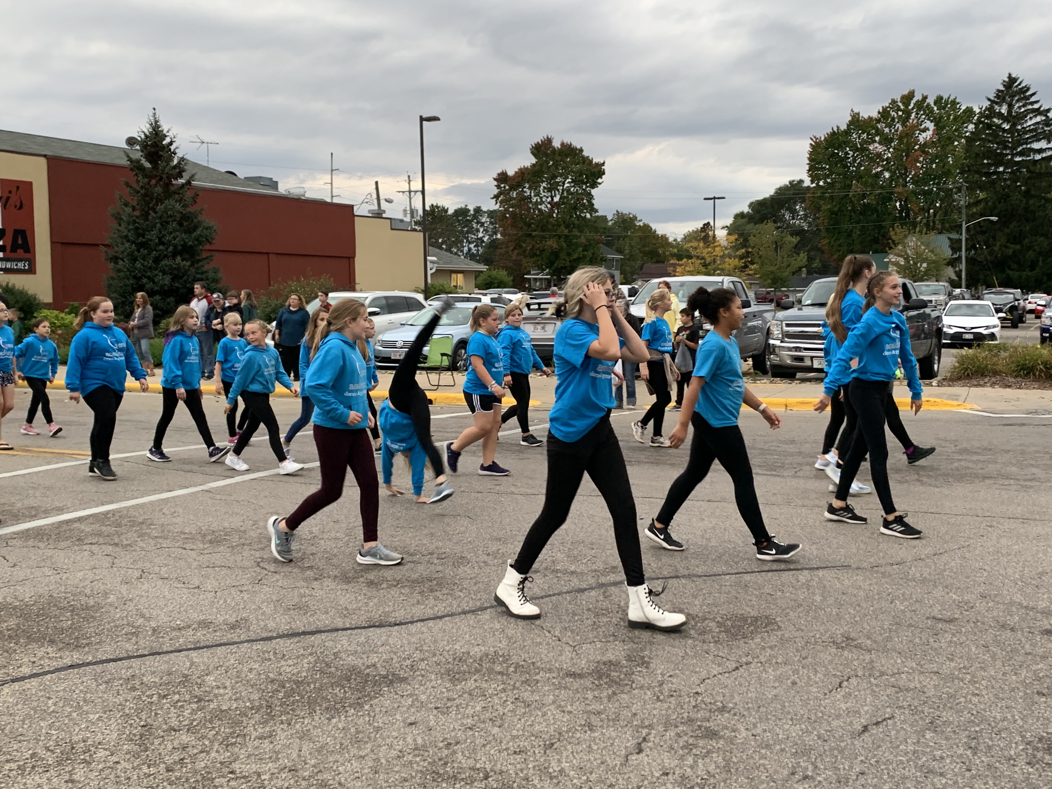 Girls involved with the Vera Dance Academy dance and cartwheel their way down Main Street during the homecoming parade on Sept. 24.Luke Reimer   NEW Media