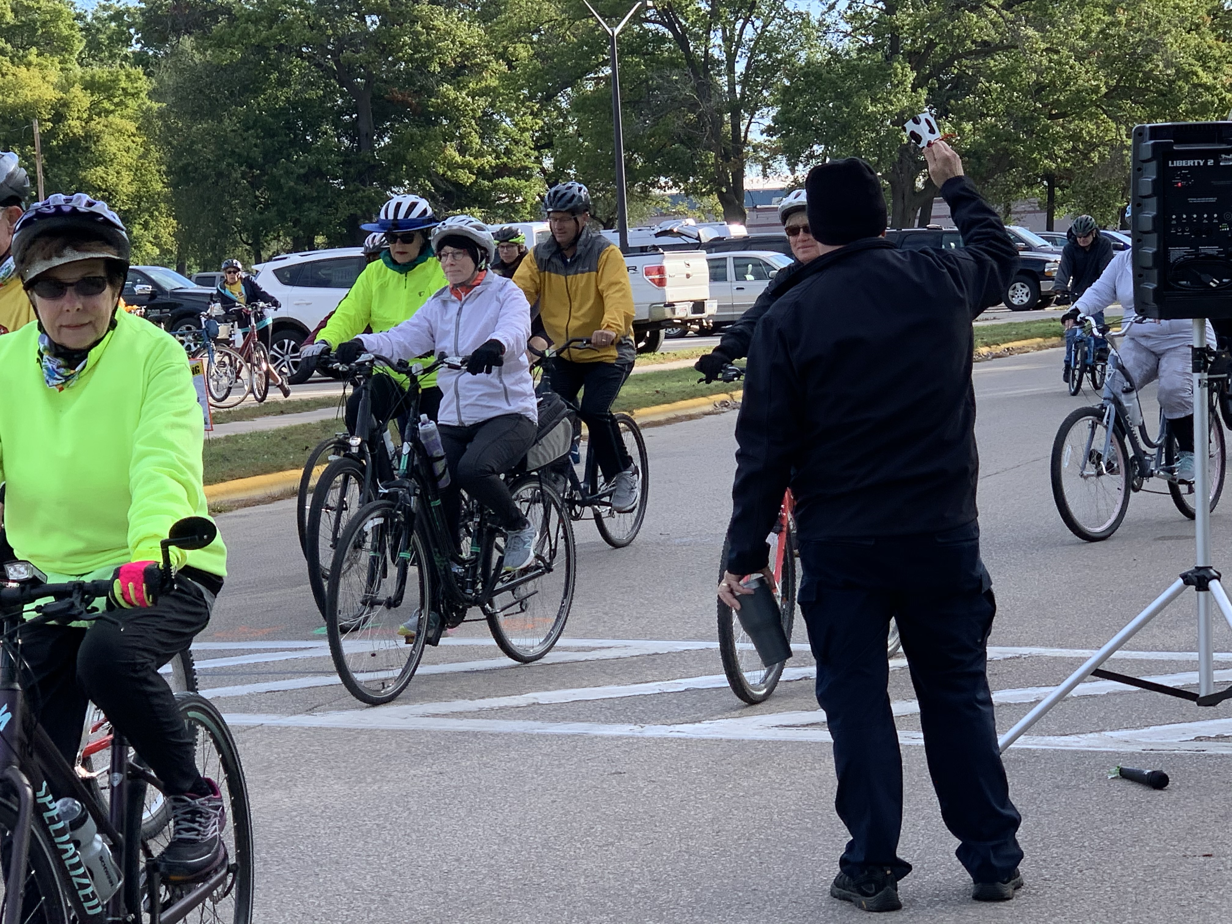 Shawano Mayor Bruce Milavitz rings a cowbell at the Bike the Barn Quilts to show support for riders as they begin their tours of Shawano County at Memorial Park on Sept. 25.Luke Reimer   NEW Media
