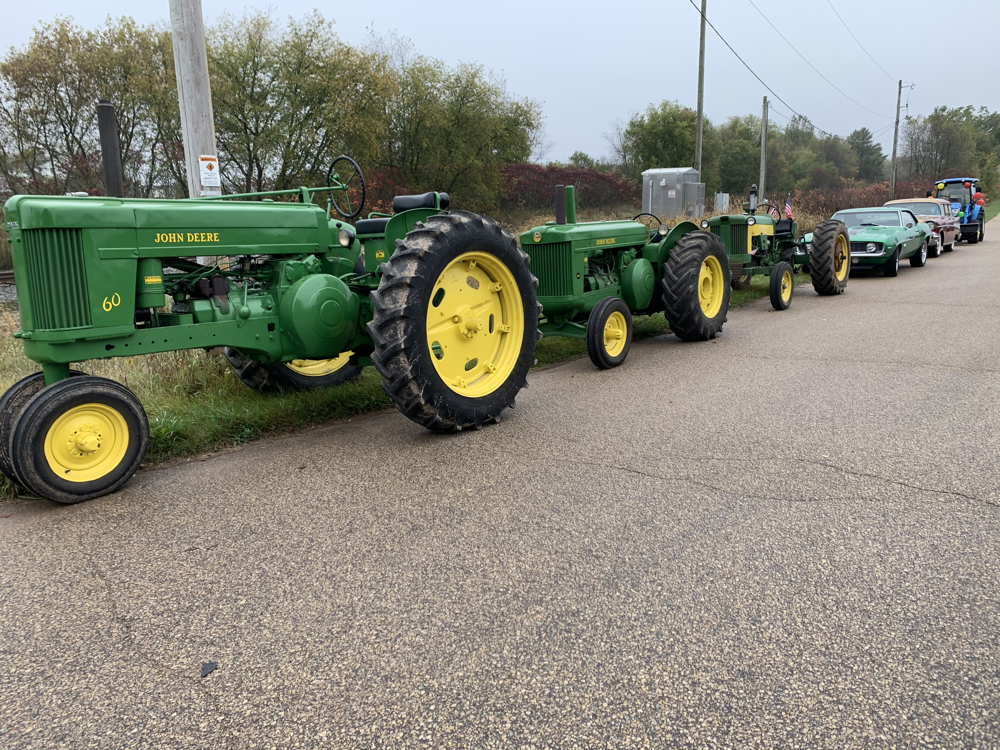 Tractors and vintage cars line up on County Road T in Lunds in preparation for the Bohemian Fest parade Oct. 9.Luke Reimer | NEW Media