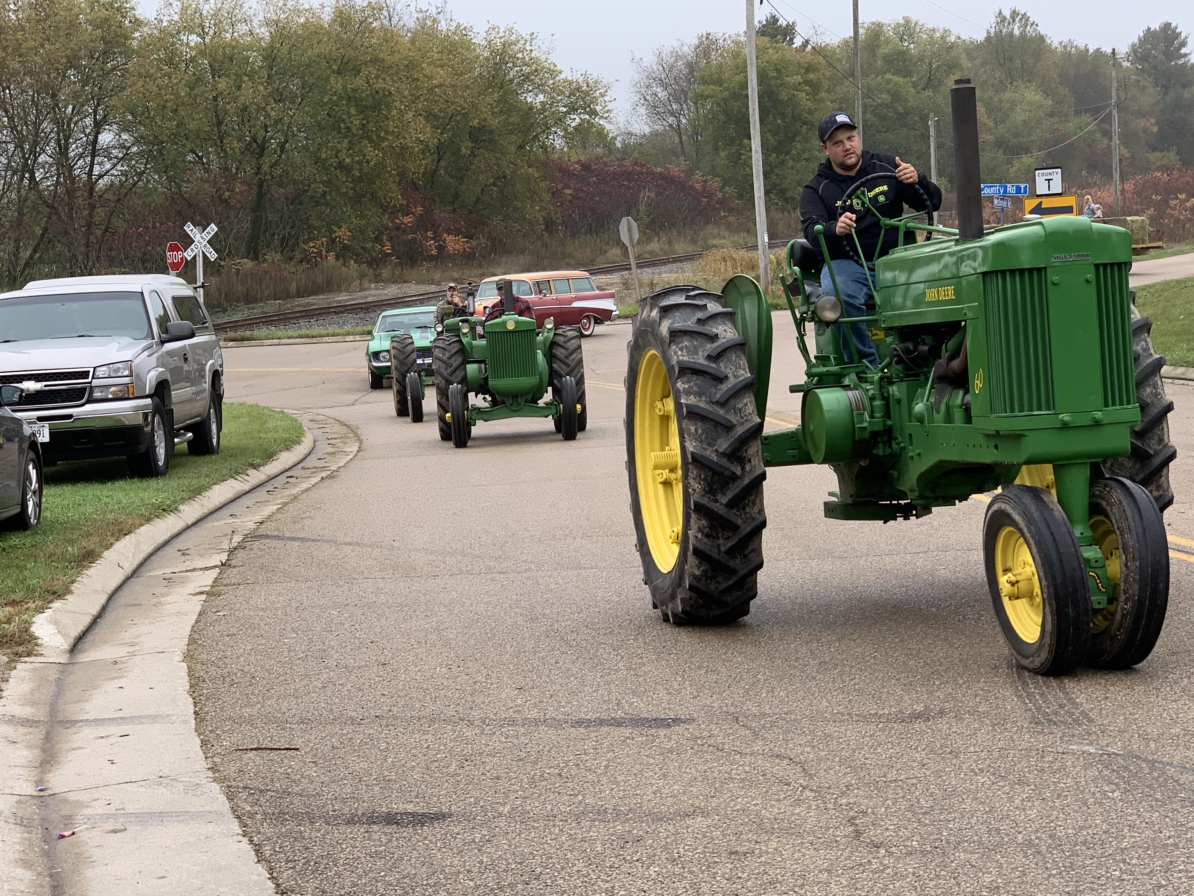 Tractors ride down County Road T in Lunds during the Bohemian Fest parade at Lunds Corner Bar on Oct. 9.Luke Reimer | NEW Media