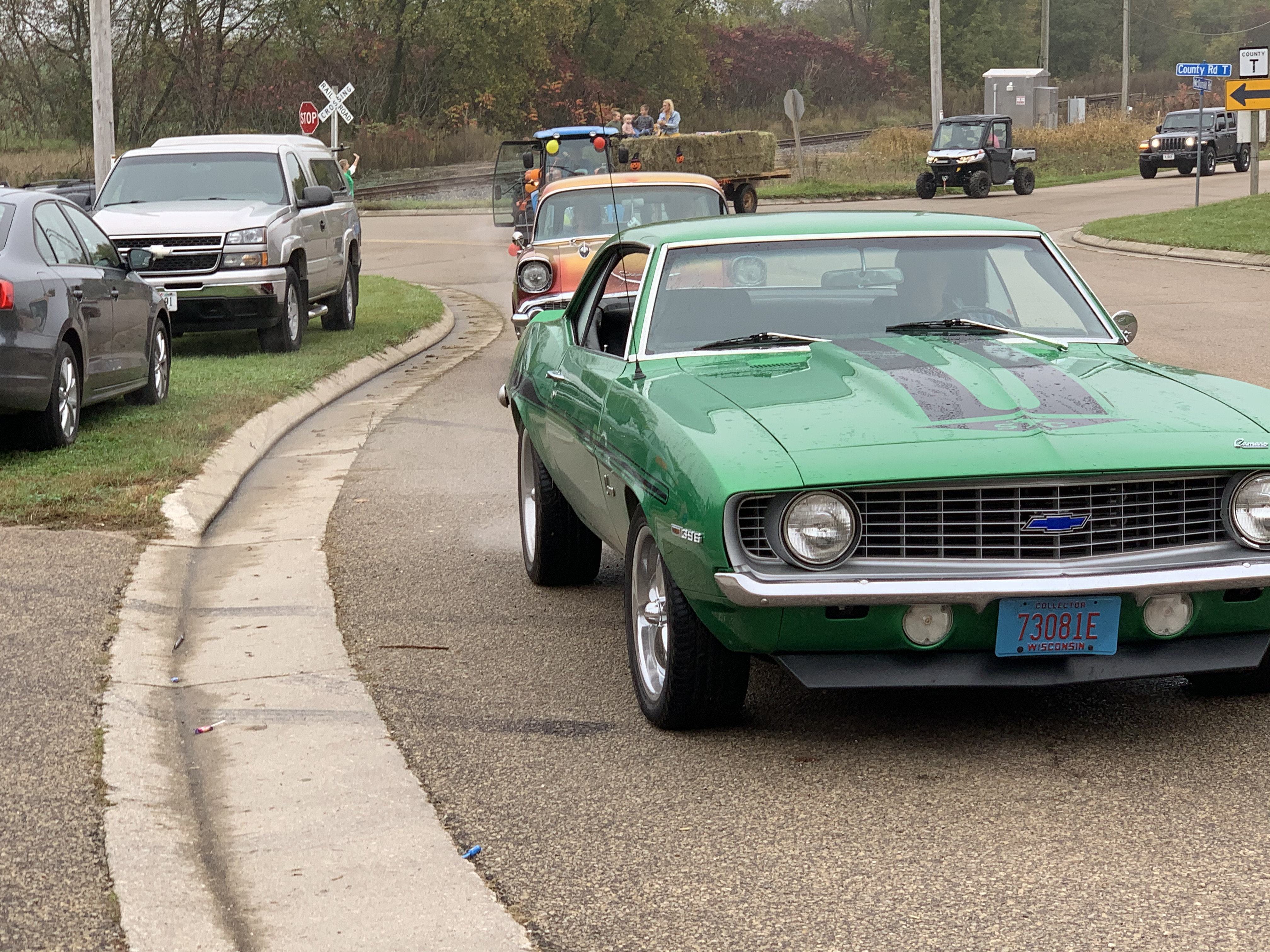 Vintage cars travel down County Road T while passengers throw candy to spectators at Bohemian Fest during the Oct. 9 parade.Luke Reimer | NEW Media