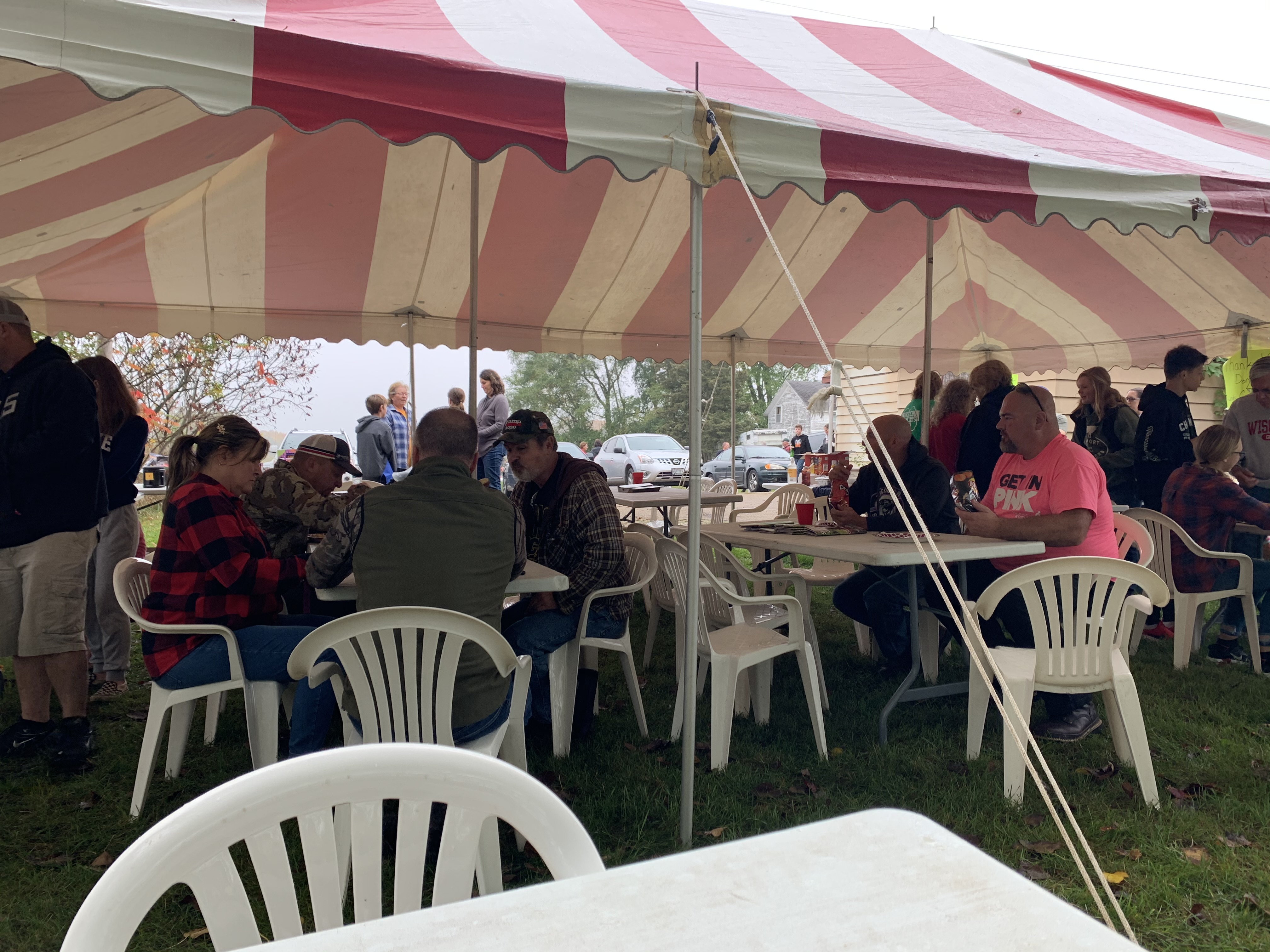Visitors pack the tent outside of Lunds Corner Bar for Bohemian Fest, where they tuck in to a lunch of Polish sausage, sauerkraut and German potato salad.Luke Reimer | NEW Media