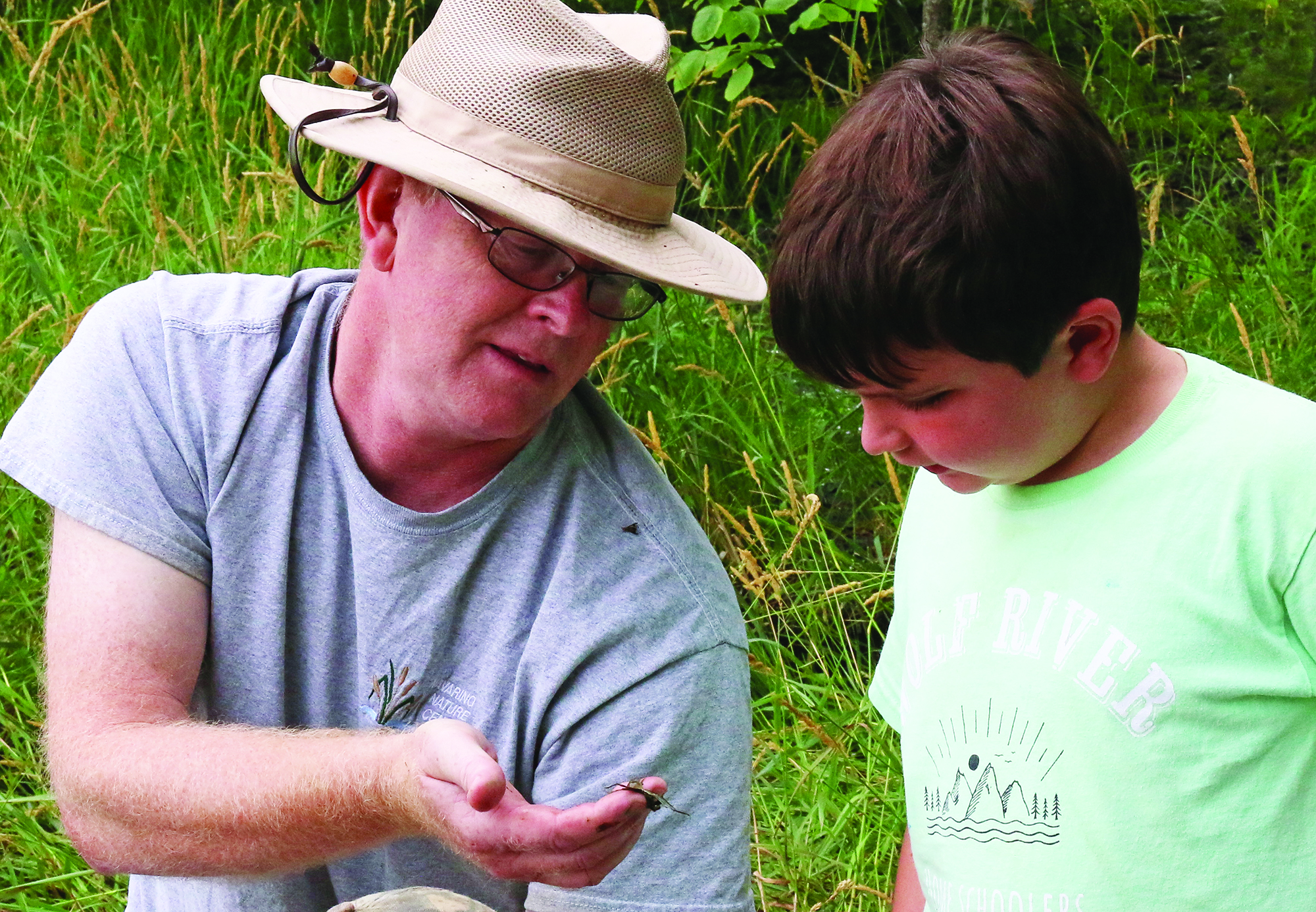 Tim Ewing talks about water insects with Matthew Briggs at Camp Creepy Crawly Critters at the Navarino Nature Center.Carol Ryczek   NEW Media