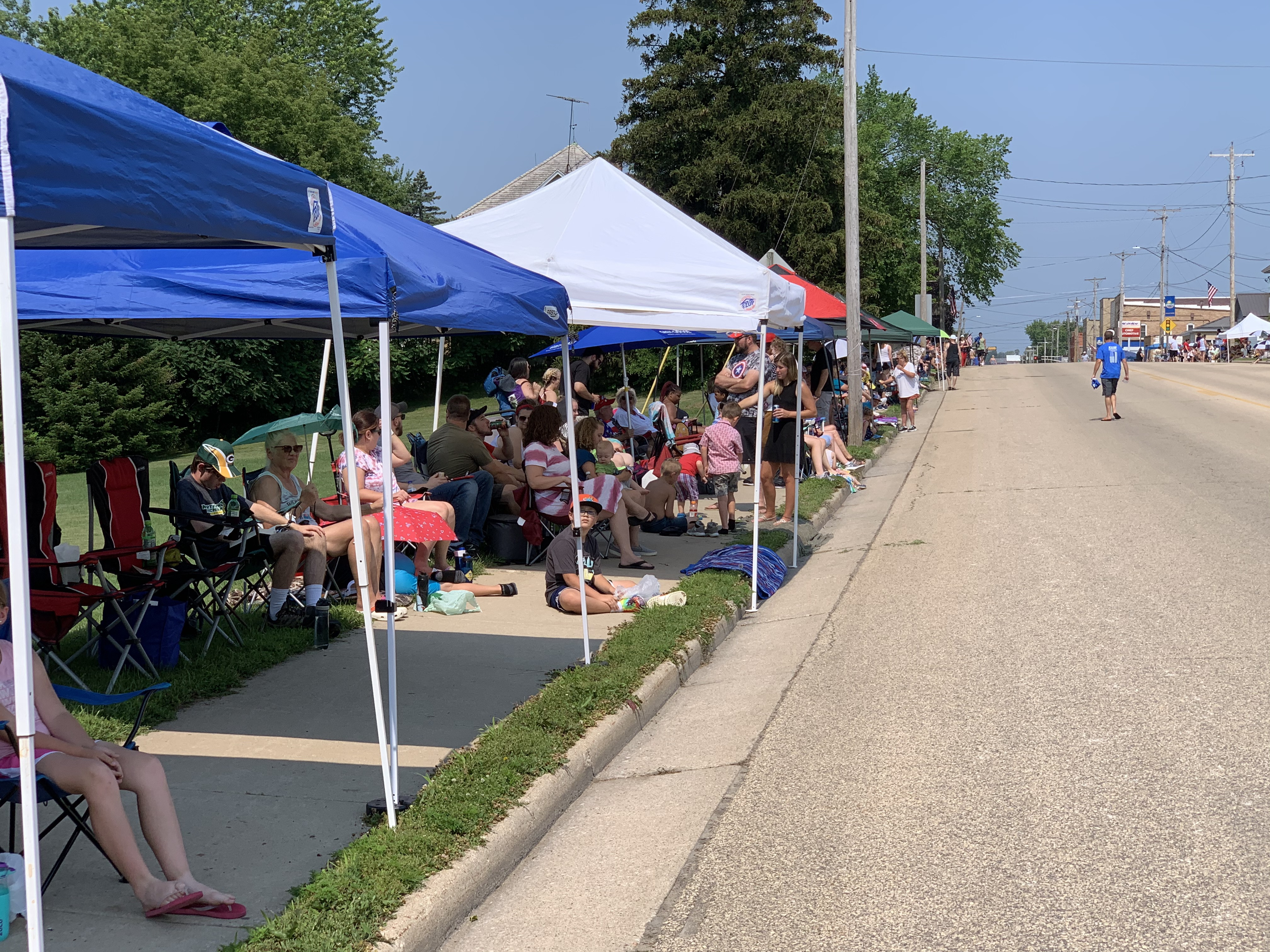 Green Bay Street was filled with tents as residents and visitors braved the heat to watch the Fourth of July parade pass in Bonduel on July 4.Luke Reimer   NEW Media