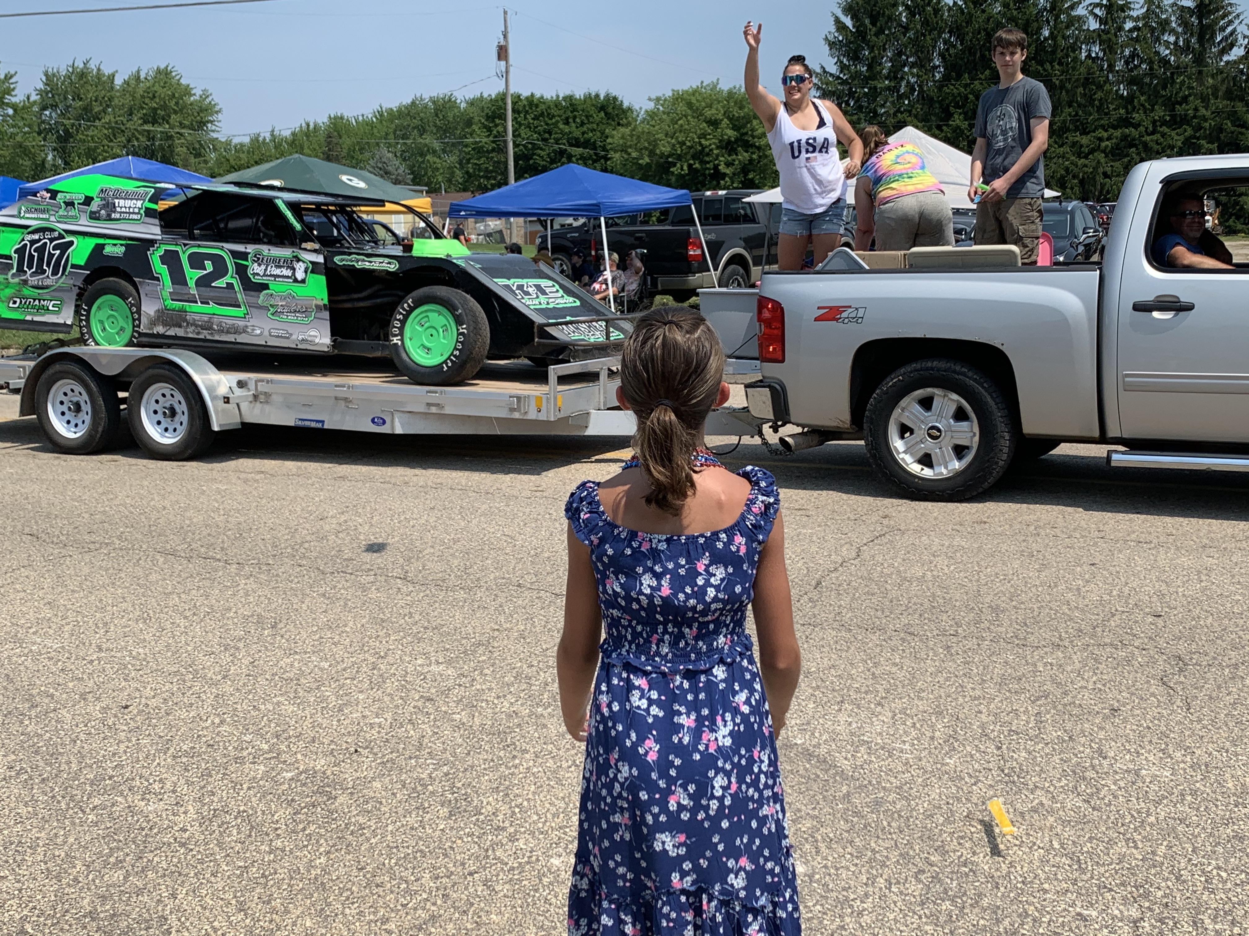 Amelia Buckoski looks on as she awaits candy to be thrown at the Fourth of July parade in Bonduel on July 4.Luke Reimer   NEW Media