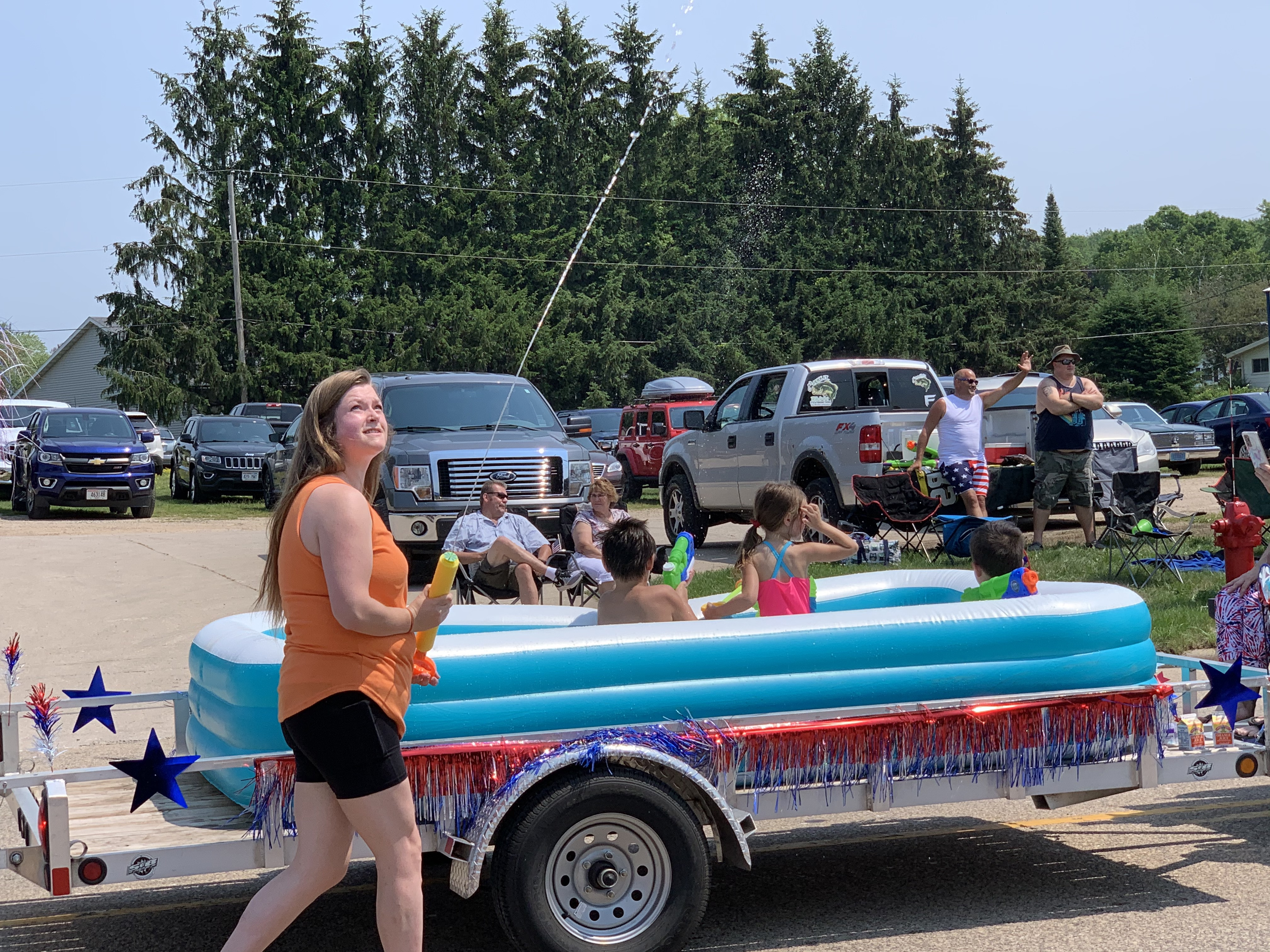 Water was squirted to cool visitors of the Fourth of July parade as temperatures reached 90 degrees in Bonduel on July 4.Luke Reimer   NEW Media