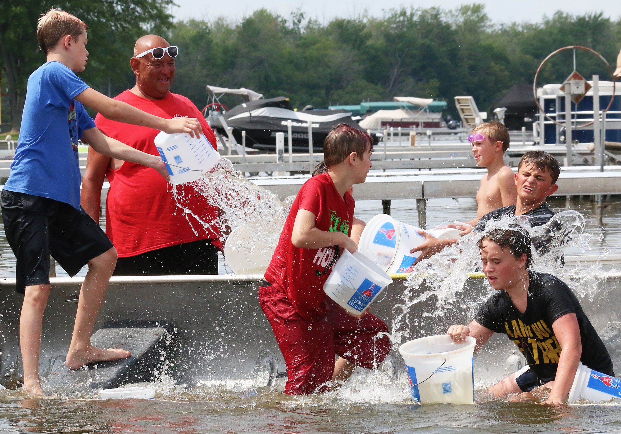 The youth participants at the annual Bamboo Bar boat sinking poured water into other teams' boats under the watchful supervision of adult judges. The event was held on a sultry Sunday afternoon on the south shore of Shawano Lake. The winning youth team won two candy bars, a soda and bragging rights.Carol Ryczek | NEW Media