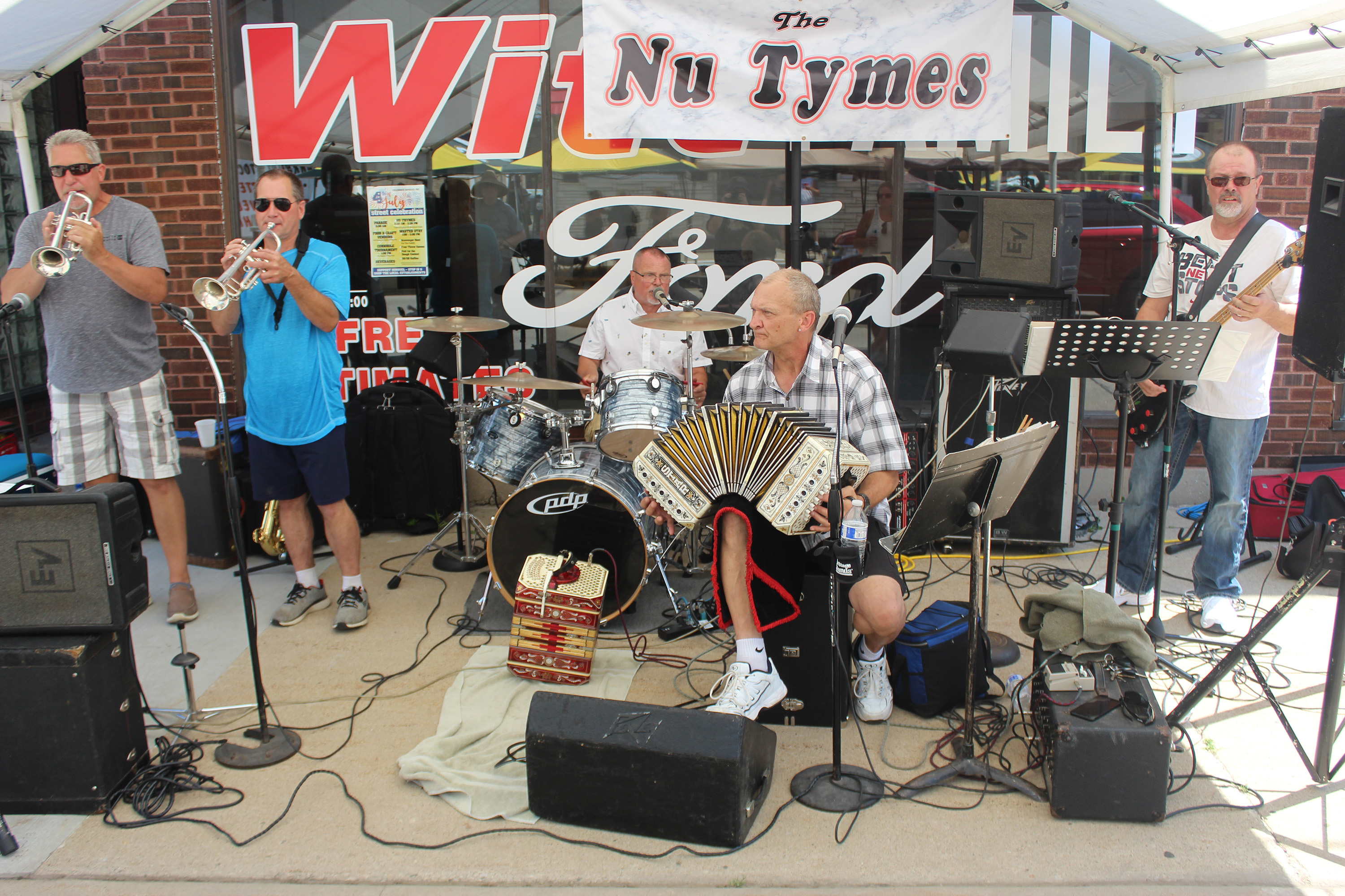 The Nu Tymes polka band, based in Pulaski, performs a song following the parade Saturday as part of a street fair in downtown Bonduel. The street fair was held as an alternative to the usual activities in Village Park.Lee Pulaski | NEW Media