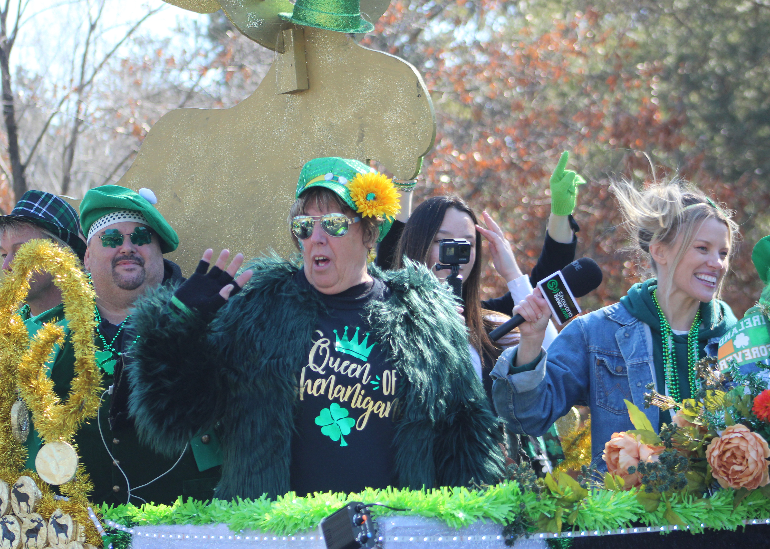 "It's unclear whether shenanigans were going on aboard this float from Just Moose'n Around, despite one of the passengers wearing a shirt that said ""Queen of Shenanigans."" What was clear was that many were having a wonderful time during the Mooseyard St. Patrick's Day Parade on March 13.(Lee Pulaski 