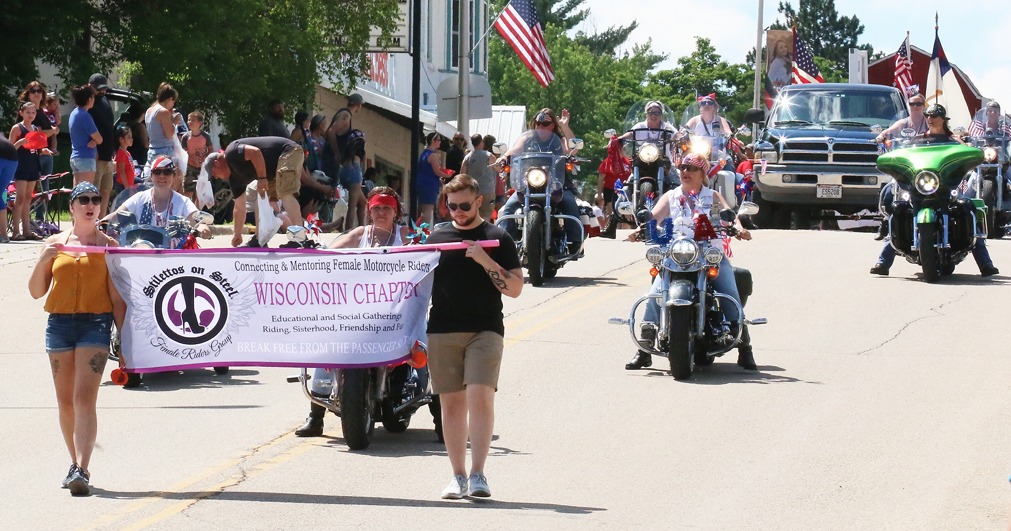 Members of Stilettos on Steel, a female motorcycle riders' group, rode down the hill on the north end of Main Street in Gresham as the July 4 parade drew to a close.Carol Ryczek | NEW Media