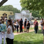 Long lines form in front of the Philly's and York food truck as visitors wait to order lunch at the Oconto County Courthouse on July 20. Proceeds of the food truck rally went back to Oconto County in order to host similar events to bring awareness to foster care.  Luke Reimer   NEW Media