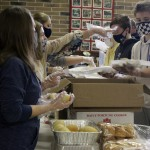 A line of volunteers waits patiently for food to be placed in to-go containers by another line of volunteers on Thanksgiving morning at St. John Lutheran Church in Pulaski. Almost 150 volunteers came out to cook, prepare, package and deliver meals in Pulaski and surrounding communities.  (Lee Pulaski | NEW Media)