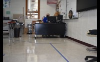 Lines on the floor are intended to remind Gillett sixth-grade teacher Bryan Brown and his students to stay 6 feet apart as much as possible.  (Warren Bluhm   NEW Media)