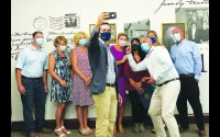 U.S. Rep. Mike Gallagher invites Nueske employees to be part of a selfie video to appease the wishes of the younger members of his staff. Gallagher was in Wittenberg on Tuesday to honor Janet Jakubek for her work as call center and order fulfillment manager at Nueske's Applewood Meats in Wittenberg.  Miriam Nelson   NEW Media