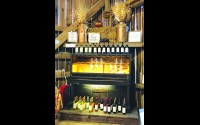 Schairer's Autumn Acres in Birnamwood has repurposed a piano featuring wine from Munson Bridge Winery, Withee, for the Thursday night Sips & Succulents events now through Oct. 8. Miriam Nelson   NEW Media