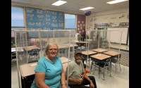 Kathy and Leonard Lindstrom, of Lena, donated materials to create desk and table dividers in Lena School recently. The Lindstroms also constructed the dividers, along with their daughters, Margaret and Marie, in honor of their late son/brother, Michael. Lena School District Superintendent Ben Pytleski said the barriers will be very helpful in mitigating the spread of illness in areas where it's not practical to space everyone 6 feet apart.  (Contributed)