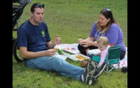John and Amanda Hunholz, of Tigerton, enjoy some barbecue for lunch Sunday with their 11-month-old daughter, Hannah, at the Embarrass River Campground.  (Lee Pulaski | NEW Media)