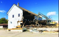 Jack Kautza has been demolishing buildings for 50 years. His company, Kautza Excavating LLC, tore down the former Backes Food Mart building in downtown Birnamwood in 8-10 hours. Miriam Nelson | NEW Media